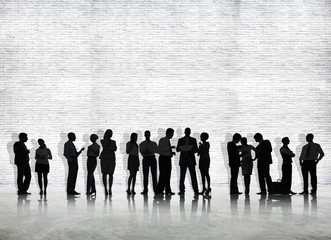 Silhouette Of Business People On Concrete Background
