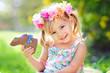 Leinwanddruck Bild - cute easter girl with chocolate bunny