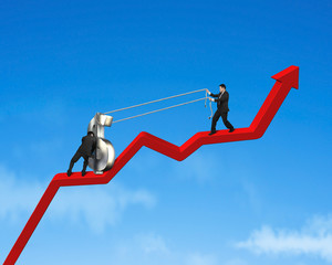 Businessmen moving up 3d money symbol on growing red arrow