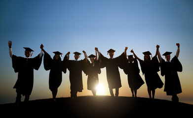 Graduating Students Celebrating At Sunset