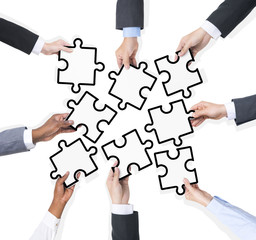 Business People Connecting Jigsaw Puzzle
