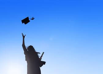 Silhouette Of Female Student Celebrating Graduation