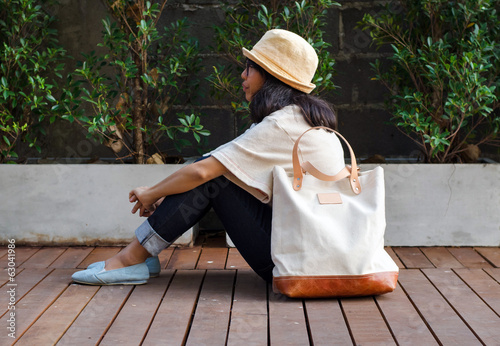 Fashion woman with a canvas bag