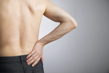 Pain in the lower back in men