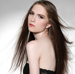 beautiful young woman with beauty long straight hairs