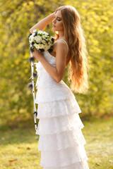 Stunning hippie bride with flowers