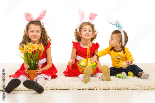Happy three kids with bunny ears