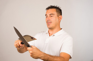 Man with kitchen knives
