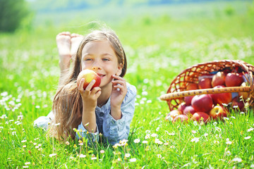 Child eating apple in a field