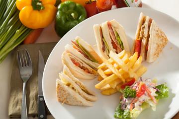 club sandwich, decorated club sandwich side with fried potato