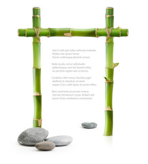 Bamboo border made of stems and stones isolated on white