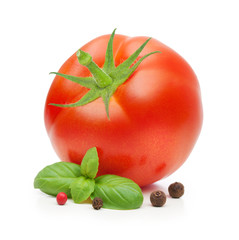 Red tomato and basil leaves spice isolated on white background.