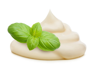 Cream and basil leaves spice isolated on white background.