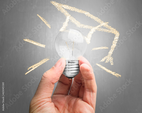Light bulb with drawing educational hat