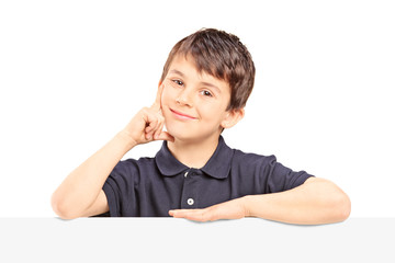 Boy posing behind blank panel