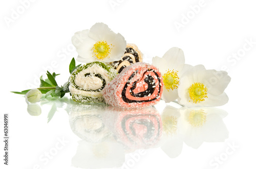 Beautiful white flower and candy isolated on white