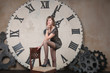 Beautiful girl in front of large clock