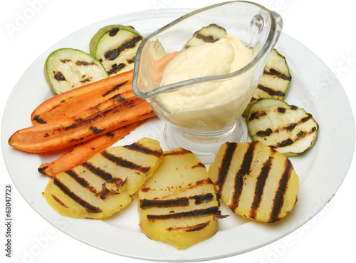 Baked vegetables: potato, carrot, eggplant on plate.
