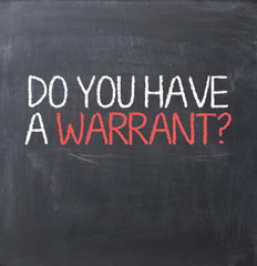 Warrant authorization document concept on blackboard