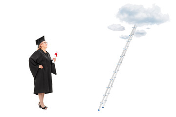 Woman holding diploma in front of a ladder