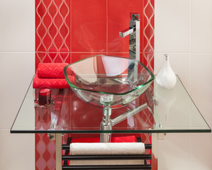 detail of a modern bathroom with a glass sink