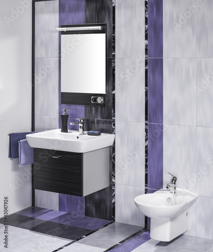 detail of an elegant bathroom interior with miror and sink with