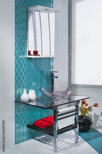 detail of a luxurious bathroom interior with turquoise and white
