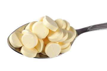 Many pills in spoon
