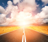 sunset road through wheat field poster