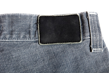 leather tag on jeans