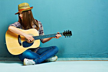 Girl fashion portrait. Model play guitar.