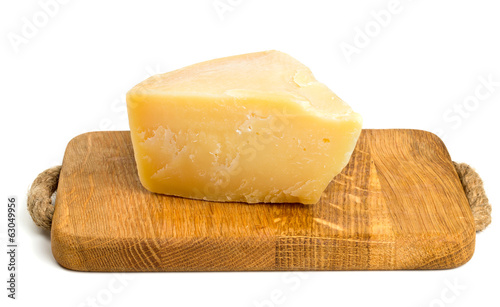 parmesan cheese on cutting board isolated