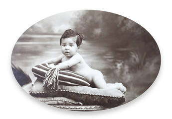 Antique Portrait of a little boy. Made ​​in a studio. Vintage.
