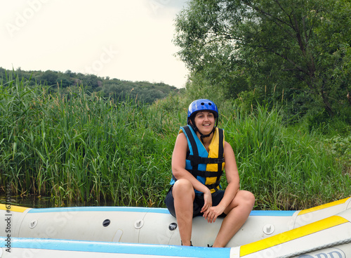 Woman going white water rafting