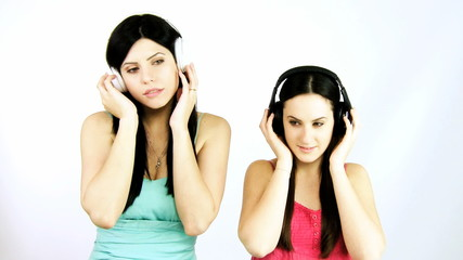 Happy girlfriends listening music