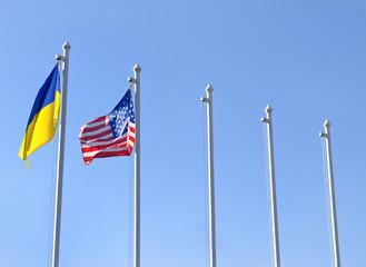 Fag of Ukraine fluttering next to the flag of USA