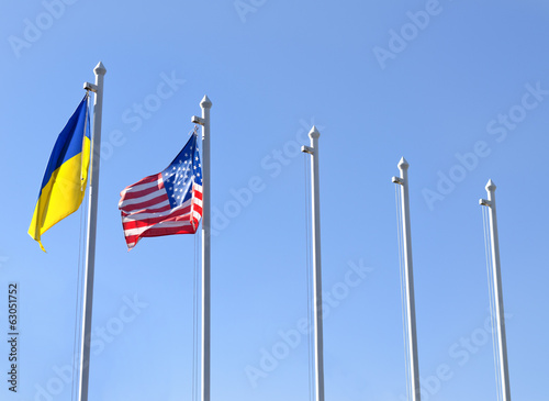 Fag of Ukraine fluttering next to the flag of USA