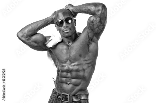 Strong bodybuilder with six pack, abs, chest, biceps,shoulders