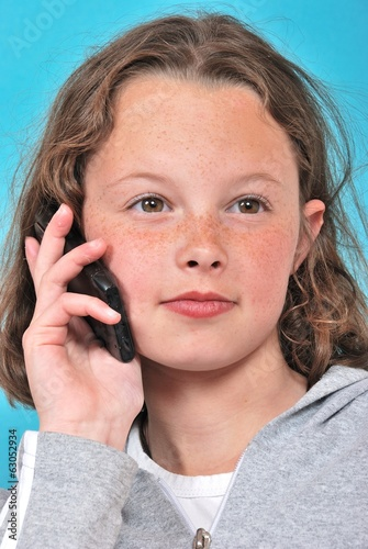 portrait of teenager phoning