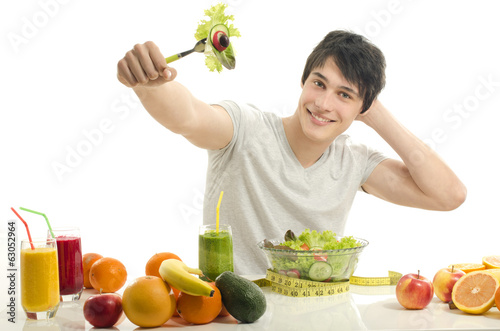 Happy man having a table full of organic food,juices,smoothie