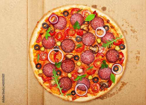 Salami pizza over box.