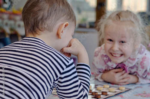 Cute little girl grinning at her brother
