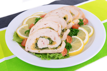 Delicious chicken roll on plate on table close-up