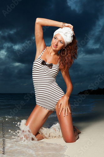 Fashion woman on the beach sunset background