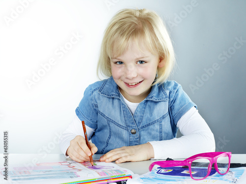 Cute blond child is proud to start at school