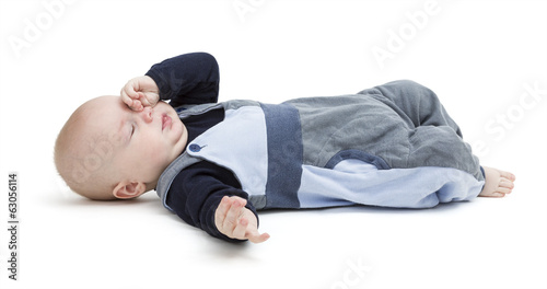 tired baby on floor isolated on white