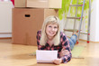 Happy woman with rental contract in front of moving boxes