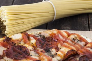 Fresh spaghetti and a pepperoni pizza