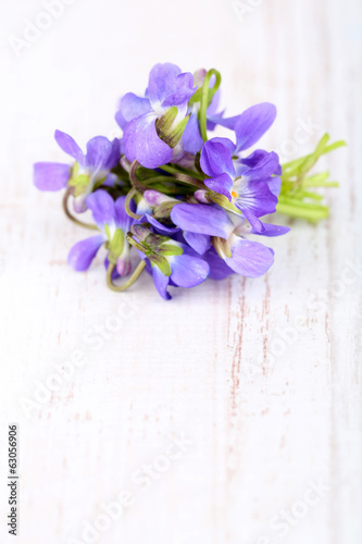 Violets flowers on wooden table