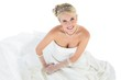 Portrait of bride sitting over white background